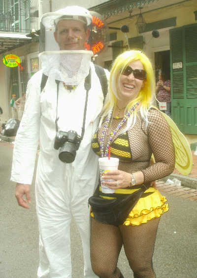 Beekeeper with his honey in Costume in French Quarter on Mardi Gras Day