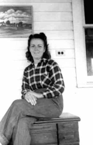 Photo of Annette sitting on back porch 1946 in Westwego