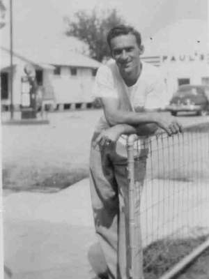 Photo of Buster leaning on 566 Ave F gate in 1948