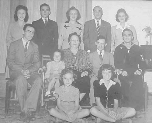 Photo of Nora & Clairville with ten children, Buster at left, seated, c. 1942