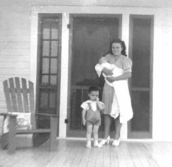 Photo of Bobby standing next Annette holding Paul in 1942